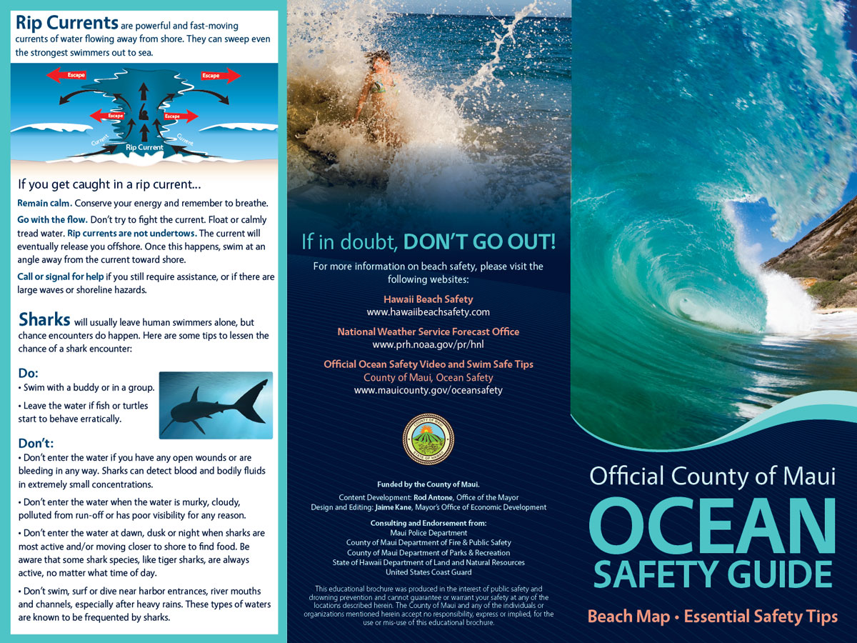 Official Maui County Ocean Safety Guide pamphlet photo of front and back.